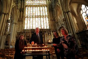 Friends of Claudia Lawrence light candles to mark the 10th anniversary of her going missing at York Minster. Pictured from the left to right are Hazel Dales, Martin Dales, Jen King and Suzy Cooper.  Picture by Simon Hulme.