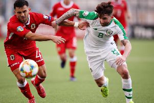 Sean Maguire battles for possession against Gibraltar's Jack Sergeant.  Photo: Getty Images