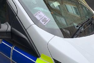 A 'do not park here' sign was stuck onto a parked police car as officers were attending a burglary. Photo: West Yorkshire Police
