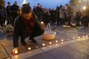 People gather ahead of a vigil at the Notre-Dame cathedral in Paris following this week's devastating fire.