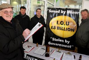 Donald Gibson adds his signiture to the Mineworkers Pension Fairplay petition, which has reached over 5000 names collected by Brian Glasper, Mick Newton and Charles Chiverton.