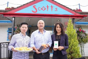 Tony Webster, owner of Scotts fish and chip shop (centre) near York, with JGOO's head of operations Xiaowen Li (left) and senior sales executive Nafisa Meme (right). Picture by Scotts Fish and Chips/PA Wire.