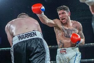 Brian Rose goes on the attack during his win over Alistair Warren. Picture: Chris Roberts for MTK Global