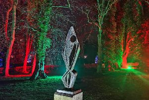 The Barbara Hepworth sculpture has been lit as a feature of the Christmas Light Show at The Alnwick Garden.