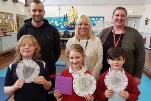 Jason, right front, Phoebe and George are pictured with Barbara Ross, centre, who is part of Morpeth's Floral Clock committee, and Morpeth First School Year 4 teachers Mrs Jefferson and Mr Smeaton.