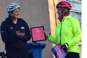 Val French (right) is the first person to lead 500 Breeze rides. She is presented with a certificate.