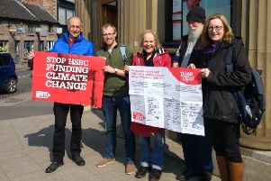 Campaigners from Belper churches visited the town's HSBC branch on Wednesday, April 17, to urge the bank to stop financing fossil fuels and their impact on the climate.