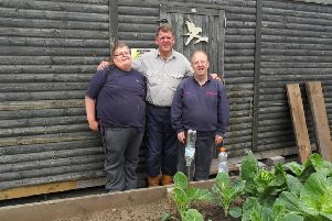 Two of the Happy Diggers members with Hft volunteer Keith McLeod.