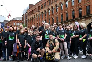 Lisa Roussos at the start line of the Manchester 10k with husband Andrew, son Xander, mayore Andy Burnham and friends and supporters of the new 22MCR charity