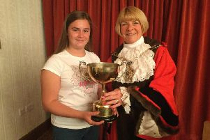 Katie Ramsbottom receives the Sheraton Trophy from outgoing Mayor of Wyre, Coun Marge Anderton