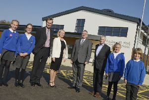 Pupils of the new Backworth Park Primary School with the Duke of Northumberland, headteacher Barbara Middleton, MP Alan Campbell and Cllr Peter Earley. Picture by Jane Coltman