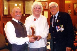 Mrs Gaul with Comrades Club member Alan Cooke (left) and Les Gilchrist the Poppy appeal organiser.