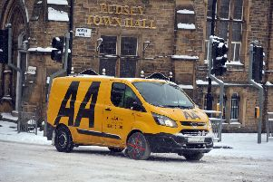 The AA on patrol in Pudsey, near Leeds, in bad weather. Picture Tony Johnson.