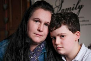 Rebecca and Denny, who suffers anxiety and travel sickness because of the 20 mile journey he makes to school twice a day. (s)