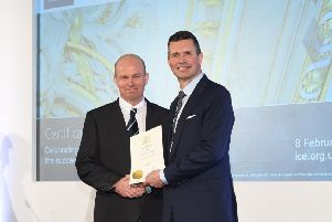Kevin Miller receives his fellowship certificate from ICE President Andrew Wyllie.