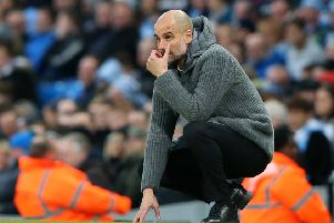 Pep Guardiola would be happy to extend his contract as manager of Manchester City. (Photo by Alex Livesey/Getty Images)