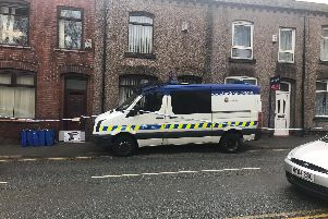Police at the scene in Leigh