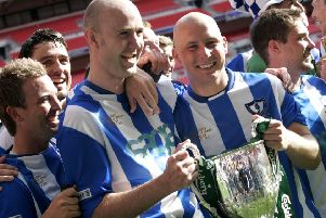 Whitley Bay FC players celebrate winning their third consecutive FA Vase trophy in 2011.