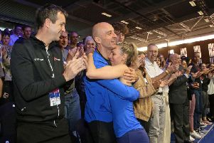 Laura Massaro hugs her husband Danny following her retirement from squash