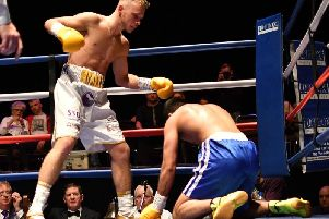 Josh Holmes sends Naheem Chaudhry to the canvas during the first round of his professional debut at King George's Hall