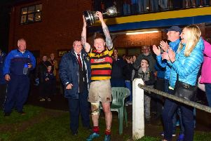 Sunderland RFC captain Joe Arrowsmith lifts the Durham County Junior Cup last night. Picture by Kevin Brady