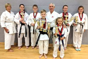 Left to right, Sensei Jill Kelly, Evie Ackroyd, Joel Pollard, Denny Shy, Sensei Andy Sherry, Charlotte Reason, Gemma Gibson and Jessica Peel.