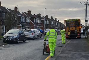Lancashire County Council staff painting single yellow lines in Broadwood Drive, Fulwood