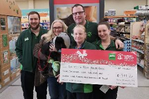 Paul Dawson and Pets at Home staff hand over a cheque to Vicki Withers from Helping Pets North East.
