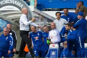 Sean Dyche celebrates victory at Stamford Bridge