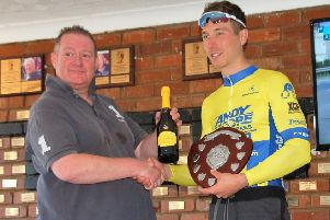 Damien 'El Dynamo' Clayton receives his trophy after victory in the Upton Cycling Club Road Race.