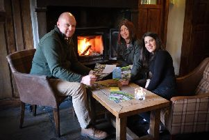 Lisa Smith of Whalley Warm and Dry (right) with Tom Pridmore and Nina Finn of the Assheton Arms in Downham. Photo by Martin Bostock.