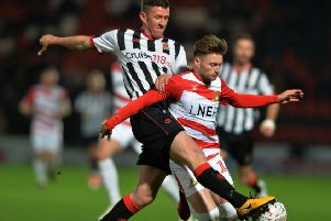 Scott Leather, left, challenges on Alfie May of Doncaster Rovers during a FA Cup 1st Round replay.