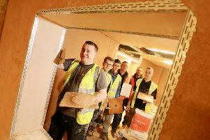 Plastering students with tutors David Hancock and Michael Anderson. Picture by Crest Photography
