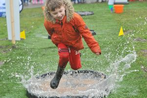 Having a splashing time - children will love to join in the Puddle Jumping Championships at WWT Martin Mere