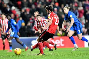 Will Grigg scores from the spot.