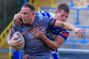 Batley centre Sam Smeaton is halted by a Halifax defender during last Sunday's narrow defeat at The Shay. The Bulldogs will be bidding for a first Championship win when they host Rochdale Hornets this week.