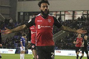 Morecambe's Jordan Cranston celebrates his goal at Oldham Athletic
