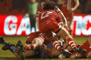 James Roby goes over for a try against Salford