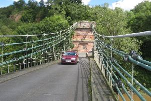 A car crossing the Union Chain Bridge linking Northumberland and Berwickshire, therefore England and Scotland. This is the oldest suspension bridge (1820) still open for traffic, a case for very slow driving.'Picture by John Wylde.