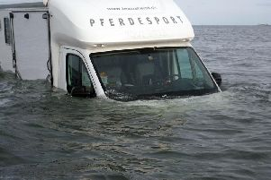 The partially submerged van on Holy Island causeway.