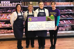 Turnbull's butcher presenting HospiceCare North Northumberland with a cheque for �2,357 from the week of fundraising activities for the hospice.
