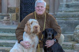 Francis Watson-Armstrong with his dogs.