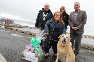 Ward councillor and civic head  Jeff Watson, enforcement officer Andrea Cowens, Coun Glen Sanderson, cabinet member for local services and the environment, with 2,000th Green Dog Walker Beverley Beers and her dog Jess. Picture by Helen Smith