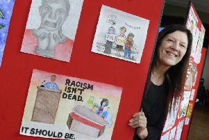 Education manager Sue Schofield with some of the entries in the Show Racism The Red Card English Schools Competition at the Linskill Centre in North Shields last week. Picture by Jane Coltman