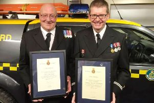 Sammy Wood, left, and Ken Henderson with their long-service awards.