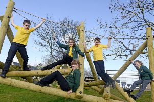 Youngsters at Warkworth Primary School enjoying their new play equipment. Picture by Jane Coltman