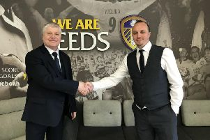 Justin Tellus (right) with a Leeds United Sports College representative.