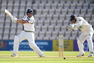 LEADING MAN: Yorkshire's Gary Ballance cuts through cover point as Hampshire wicketkeeper Lewis McManus looks on at The Ageas Bowl. Picture: Mike Hewitt/Getty Images
