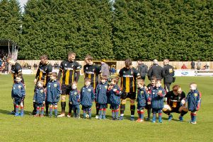 The Longhoughton Lions mascots line-up on the pitch with Morpeth Town.