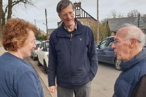 John Appleby speaks with residents in Longframlington during his campaigning.